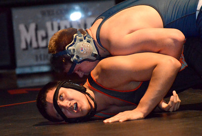 Monica Maschak - mmaschak@shawmedia.com Luis Hernandez fights to stay up as his head gear slides down his face and his 220-pound Cary-Grove opponent Nick Huff tries to keep him on the mat.  Hernandez came out victorious 5-4 and McHenry East won 42-19.