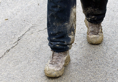 H. Rick Bamman - hbamman@shawmedia.com Carpenter Brian Gordon's boots are caked in mud as he works on a house on Caldwell Drive in the Coventry Lakes subdivision in Lake in the Hills.