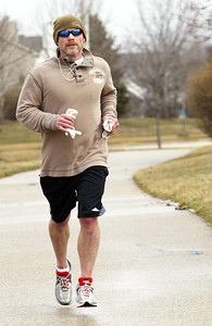 H. Rick Bamman - hbamman@shawmedia.com Todd Colton takes enjoys Monday's mild temperatures as he runs along Miller Road in Lake in the Hills.