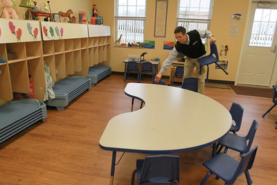 Michael Petrucelli, owner of the Goddard School in Darien, sets out chairs during their open house on Saturday, Jan. 12. Sarah Minor — sminor@shawmedia.com