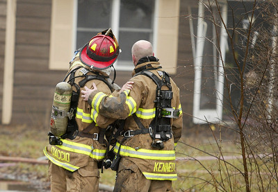 H, Rick Bamman - hbamman@shawmedia.com Firefighters discuss areas to vent the house fire at 1430 Cary Algonquin Rd. Wednesday.