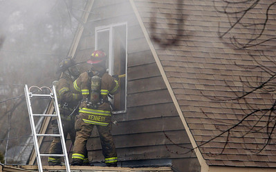 H. Rick Bamman - hbamman@shawmedia.com Firefighters work to vent the second floor of a home at 1430 Cary Algonquin Rd. Wednesday afternoon.