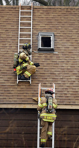 H. Rick Bamman - hbamman@shawmedia.com Firefighters work to vent the second floor of a house at 1430 Cary Algonquin Rd. Wednesday, January 30, 2013.