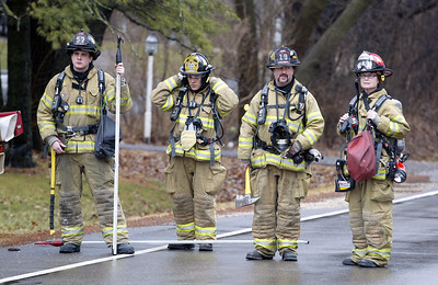 H, Rick Bamman - hbamman@shawmedia.com Firefighters wait to be assiged at the house fire on Cary Algonquin Rd.