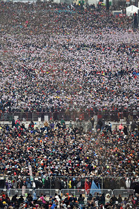 A crowd fills up the National Mall before at the ceremonial swearing-in of President Barack Obama at the U.S. Capitol during the 57th Presidential Inauguration in Washington, Monday, Jan. 21, 2013. (AP Photo/Carolyn Kaster)