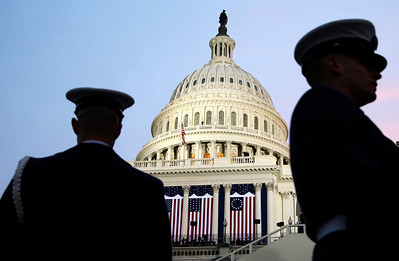 Ceremonial Coast Guard honor guards frame the U.S. Capitol before the ceremonial swearing-in of President Barack Obama during the 57th Presidential Inauguration in Washington, Monday, Jan. 21, 2013. (AP Photo/Evan Vucci)