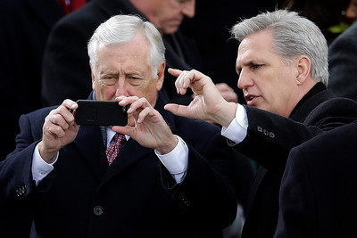 House Minority Whip Steny Hoyer of Md., left, gets help with his cellphone camera from House Majority Whip Kevin McCarthy of Calif., on Capitol Hill in Washington, Monday, Jan. 21, 2013, prior to the start of President Barack Obama's ceremonial swearing-in ceremony during the during the 57th Presidential Inauguration. (AP Photo/Carolyn Kaster)