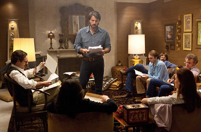 """This film image released by Warner Bros. Pictures shows Ben Affleck as Tony Mendez, center, in """"Argo,""""  a rescue thriller about the 1979 Iranian hostage crisis. The film was nominated for an Academy Award for best picture on Thursday, Jan. 10, 2013.  The 85th Academy Awards will air live on Sunday, Feb. 24, 2013 on ABC.  (AP Photo/Warner Bros., Claire Folger)"""