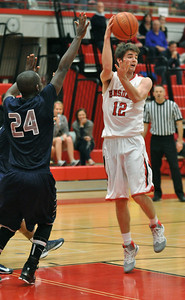 Hinsdale Central's Jared Eck flips a pass to a teammate from the freethrow line in the Red Devils' 58-46 win at home against Oswego East on Tuesday, Jan. 8, 2013. Bill Ackerman — backerman@shawmedia.com
