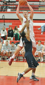 Hinsdale Central's Matt Rafferty pulls down a sideline pass from teammate Jared Eck and put up a shot in the Red Devils' 58-46 win at home against Oswego East on Tuesday, Jan. 8, 2013. Bill Ackerman — backerman@shawmedia.com