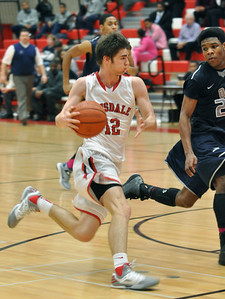 Hinsdale Central's Jared Eck motors to the basket on a turnover at home against Oswego East on Tuesday, Jan. 8, 2013. Bill Ackerman — backerman@shawmedia.com