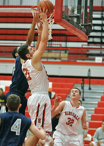 Hinsdale Central's Rigas Pappas (#21) takes the ball right to the hoop at home against Oswego East on Tuesday, Jan. 8, 2013. Bill Ackerman — backerman@shawmedia.com
