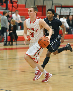 Hinsdale Central's Alec Hutcherson breaks down the court in the Red Devils' 58-46 win at home against Oswego East on Tuesday, Jan. 8, 2013. Bill Ackerman — backerman@shawmedia.com