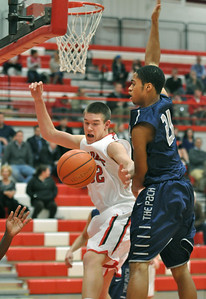 Hinsdale Central's Matt Rafferty (left) will recover the loose ball in the Red Devils' 58-46 win at home against Oswego East on Tuesday, Jan. 8, 2013. Bill Ackerman — backerman@shawmedia.com
