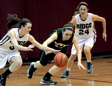 Sarah Nader - snader@shawmedia.com Prairie Ridge's Brianne Fenton (left) steals the ball from Crystal Lake South's Stephanie Oros during the third quarter of Friday's game in Crystal Lake on January 4, 2012. Crystal Lake South won, 38-34.