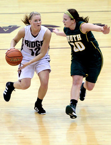 Sarah Nader - snader@shawmedia.com Prairie Ridge's Amanda Hoyland (left) is guarded by Crystal Lake South's Rachel Rasmussen during the first quarter of Friday's game in Crystal Lake on January 4, 2012. Crystal Lake South won, 38-34.