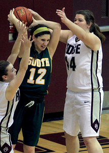 Sarah Nader - snader@shawmedia.com Crystal Lake South's Carly Nolan (center) fights for the ball during Friday's game against Prairie Ridge in Crystal Lake on January 4, 2012. Crystal Lake South won, 38-34.