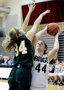 Sarah Nader - snader@shawmedia.com Prairie Ridge's Maddie Drain (right) tries to shoot over Crystal Lake South's Sara Mickow during the fourth quarter of Friday's game in Crystal Lake on January 4, 2012. Crystal Lake South won, 38-34.
