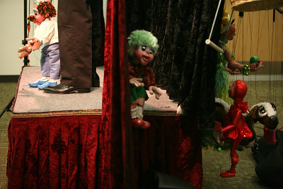 Chef Wolfgang Von Puppenspiel takes the stage as other puppets wait in the wings on Wednesday, Jan. 8 at Addison Public Library. Sarah Minor — sminor@shawmedia.com