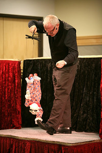 """Stripes the peppermint clown does a hand stand on Dave Herzog's foot during """"Puppet Soup"""" on Wednesday, Jan. 9. Sarah Minor — sminor@shawmedia.com"""