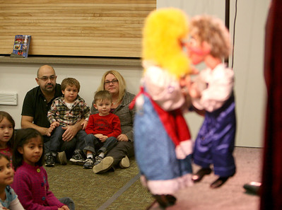 """Kathy Risolvo watches """"Puppet Show"""" at Addison Public Library with her husband, Aldo, her son, Giuseppe, 3, and cousin, Rylie Mueller-Klugge, 2, on Wednesday, Jan. 9. Sarah Minor — sminor@shawmedia.com"""
