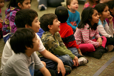 """Children laugh as they watch """"Puppet Soup"""" at Addison Publisc Library on Wednesday, Jan. 9. Sarah Minor — sminor@shawmedia.com"""