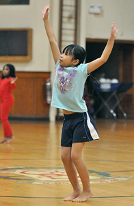 "Mikaela Colagrossi, 7, of Lyons, learns a routine to the ""Hamster Dance"" incorporating dance and gymnastics skills at Sokol Tabor in Berwyn on Thursday, Jan. 17, 2013. Bill Ackerman — backerman@shawmedia.com"