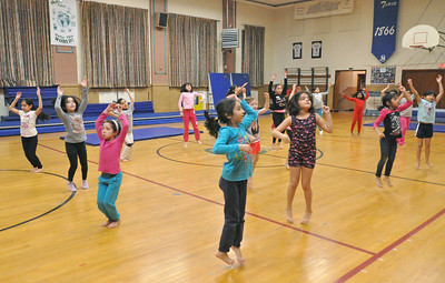 "Kids learn a routine to the ""Hamster Dance"" incorporating dance and gymnastics skills at Sokol Tabor in Berwyn on Thursday, Jan. 17, 2013. Bill Ackerman — backerman@shawmedia.com"