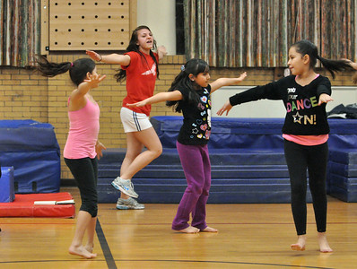"instructor Hallie Soulides leads kids as they learn a routine to the ""Hamster Dance"" incorporating dance and gymnastics skills at Sokol Tabor in Berwyn on Thursday, Jan. 17, 2013. Bill Ackerman — backerman@shawmedia.com"