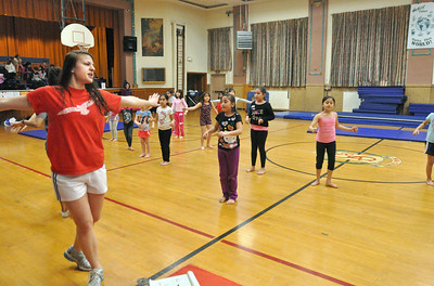 "instructor Hallie Soulides (left) leads kids as they learn a routine to the ""Hamster Dance"" incorporating dance and gymnastics skills at Sokol Tabor in Berwyn on Thursday, Jan. 17, 2013. Bill Ackerman — backerman@shawmedia.com"
