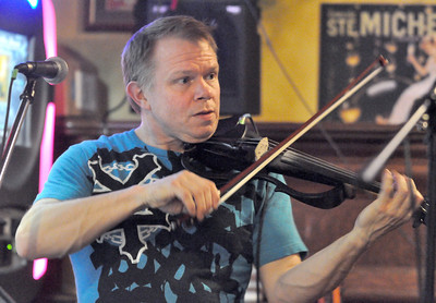 Tom Culver steps away from his day job as a music educator at La Grange School District 102 to play the electric violin with his band, Strung Out, at the The Kerry Piper, in Willowbrook, on Friday night, Jan. 11, 2013. Bill Ackerman — backerman@shawmedia.com