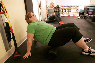 Monica Maschak - mmaschak@shawmedia.com Patient Cindy Smith (front) and trainer Lauren Logue use a foam roller to begin their 8 Weeks to Wellness fitness session at the Premier Wellness Chiropractic office.  The foam roller helps to work out muscular kinks in th back and other parts of the body.