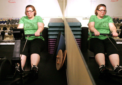 Monica Maschak - mmaschak@shawmedia.com Patient Cindy Smith uses a rowing machine to warm up for her fitness training session at the Premier Wellness Chiropractic office in Crystal Lake.  The chiropractic center is one of three in the state that offers the 8 Weeks to Wellness program.