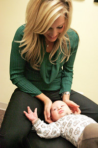 Monica Maschak - mmaschak@shawmedia.com Dr. Amy Neff adjusts four-month-old Isaac Sharp. Chiropractic adjustments are for all ages, and can help improve digestion and joint and muscle pain.