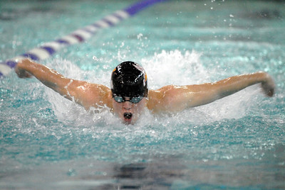 Benet Academy's Paddy Lawler swims in the 100-yard butterfly during the Trojan Boys Invitational swimming and diving meet at Downers Grove North High School on Saturday, Jan. 19, 2013. Lawler finished first in the heat, with a time of 58.43. Matthew Piechalak— mpiechalak@shawmedia.com.