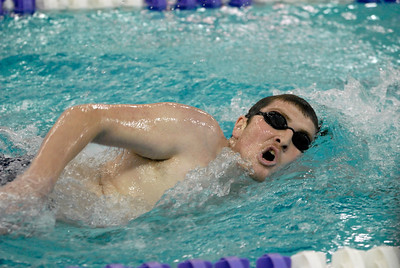 Downers Grove South's Karl Nika swims in the 500-yard freestyle during the Trojan Boys Invitational swimming and diving meet at Downers Grove North High School on Saturday, Jan. 19, 2013. Nika finished first in the heat, with a time of 5:45.06. Matthew Piechalak— mpiechalak@shawmedia.com.