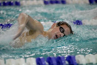 Lyons Township's Brendan Weibel swims in the 500-yard freestyle during the Trojan Boys Invitational swimming and diving meet at Downers Grove North High School on Saturday, Jan. 19, 2013. Matthew Piechalak— mpiechalak@shawmedia.com.