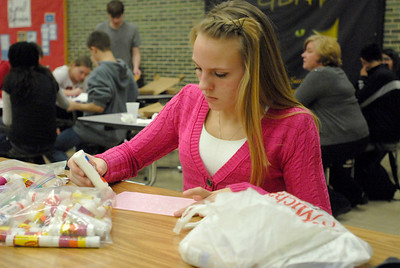 Glenbard North senior Maggie Wynn uses glue and sparkles to create the cover of her Valentine's Day card during the Glenbard District 87 Valentine's For Vets event at Glenbard North High School in Carol Stream on Wednesday, Jan. 30, 2013. Matthew Piechalak— mpiechalak@shawmedia.com.