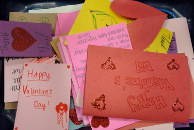 Completed Valentine's Day cards are piled in a box during the Glenbard District 87 Valentine's For Vets event at Glenbard North High School in Carol Stream on Wednesday, Jan. 30, 2013. Matthew Piechalak— mpiechalak@shawmedia.com.
