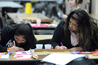 Glenbard North senior Fabiola Montes, right, and her sister, freshman Maricarmen work to create Valentine's Day cards during the Glenbard District 87 Valentine's For Vets event at Glenbard North High School in Carol Stream on Wednesday, Jan. 30, 2013. Matthew Piechalak— mpiechalak@shawmedia.com.