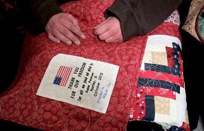 Sarah Nader - snader@shawmedia.com A veteran holds his quilt that was donated to him by the Huntley Quilts of Valor group Thursday, January 10, 2013.