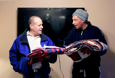 Sarah Nader - snader@shawmedia.com Veterans Larry Posner (left) and Fred Guinn of Hebron received  homemade quilts that were donated by the Huntley Quilts of Valor group to the veterans at Transitional Living Services in Hebron on Thursday, January 10, 2013.  Two months ago the group didn't think they would have enough money to keep quilting for veterans in 2013. They have since received more donors and will be quilting for another year. 20 quilts were donated to Transitional Living Services.