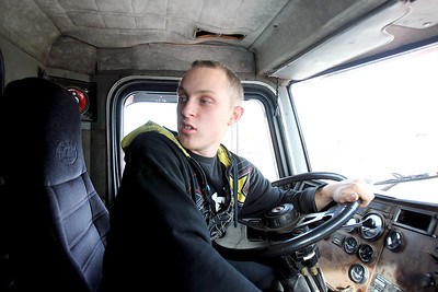 Sarah Nader - snader@shawmedia.com Cody Katenhusen, 18, of Johnsburg drives a semi truck during his heavy equipment/diesel mechanics class at Johnsburg High School on Thursday, January 24, 2013. Katenhusen received his CDL last year, six months after receiving his driving license.