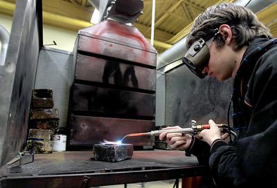 Sarah Nader - snader@shawmedia.com A.J. Bates, 17, of Johnsburg welds in his welding class at Johnsburg High School on Thursday, January 24, 2013.