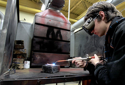 Sarah Nader - snader@shawmedia.com A.J. Bates, 17, of Johnsburg welds in his welding class at Johnsburg High School on Thursday, January 24, 2013.
