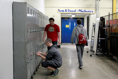 Sarah Nader - snader@shawmedia.com Johnsburg High School students change classes after their welding class on Thursday, January 24, 2013