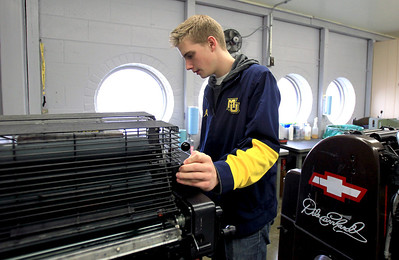 Sarah Nader - snader@shawmedia.com Stteffen Miller, 17, of Johnsburg runs the offset printer while in his graphic production class at Johnsburg High School on Thursday, January 24, 2013.