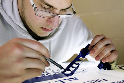 Sarah Nader - snader@shawmedia.com Daniel Volpendesta, 16, of Johnsburg weeds out  lettering while making a sign for the PTO while in his graphic production class at Johnsburg High School on Thursday, January 24, 2013. The school is expanding their vocational programs next year. Some classes will be expanded to full semesters and more level classes will be added.