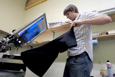 Sarah Nader - snader@shawmedia.com Alex Harnack , 19, of Johnsburg screen prints a t-shirt while in his graphic production class at Johnsburg High School on Thursday, January 24, 2013.