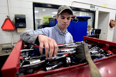 Sarah Nader - snader@shawmedia.com Lance DeRosa, 18, of Johnsburg looks for a tool while fixing up a truck in his heavy equipment/diesel mechanics class at Johnsburg High School on Thursday, January 24, 2013. The school is expanding their vocational programs next year. Some classes will be expanded to full semesters and more level classes will be added to others.